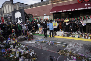 People gather at Cup Foods after a guilty verdict was announced at the trial of former Minneapolis police Officer Derek Chauvin for the 2020 death of George Floyd, Tuesday, April 20, 2021, in Minneapolis,